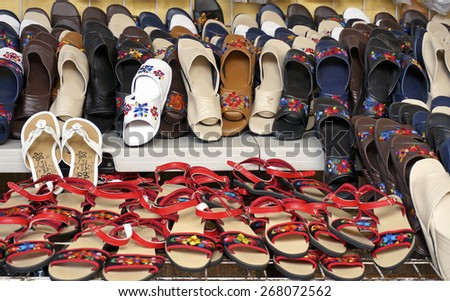 Merida, Yucatan Mexico, January 25, 2015: An arrangement of shoes for sale in one of the street markets in Merida Mexico. - stock photo