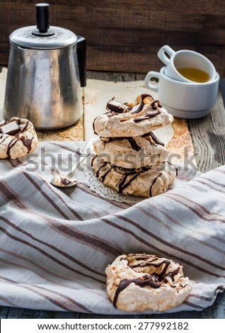 meringue cake with chocolate, caramel and nuts, dessert, rustic, french cuisine, selective focus - stock photo