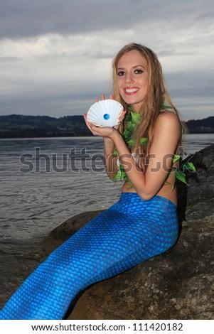 Mermaid and shell - stock photo