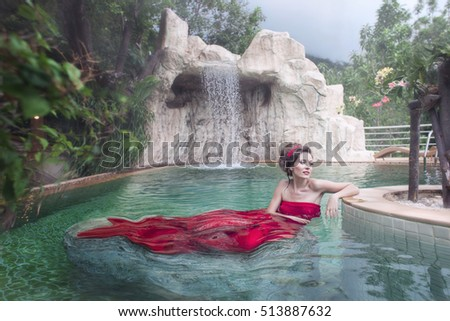 Mermaid. The girl in the pool