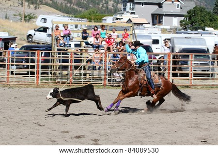MERRITT, B.C. CANADA - SEPTEMBER 3: Cowboy during the calf roping event at The 52nd Annual Pro Rodeo September 3, 2011 in Merritt British Columbia, Canada - stock photo