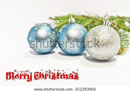 Merry Christmas and decorative ball on the white background