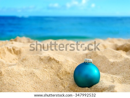 Merry Christmas and Happy New Year background, Christmas ball on the tropical beach near ocean in Hawaii - stock photo