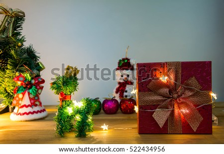 Merry Christmas and happy new year event on wood . Open Warm white light