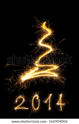Merry christmas and happy new year 2014. Sparkling firework christmas and new year text on black background. Minimal abstract artistic style.