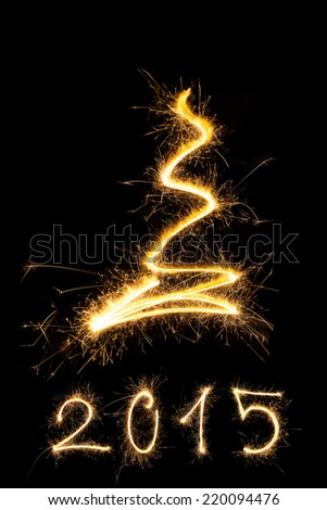 Merry christmas and happy new year 2015. Sparkling firework christmas and new year text on black background. Minimal abstract artistic style. - stock photo