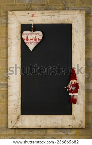 Merry Christmas and Happy New Years chalkboard blackboard heart and puppet decoration restaurant vintage menu design on painted reclaimed wooden frame, light brown brick wall, copy space