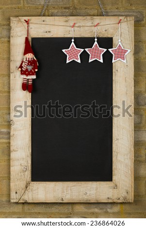 Merry Christmas and Happy New Years chalkboard blackboard tin owl decoration restaurant vintage menu design on painted reclaimed wooden frame, light brown brick wall, copy space - stock photo
