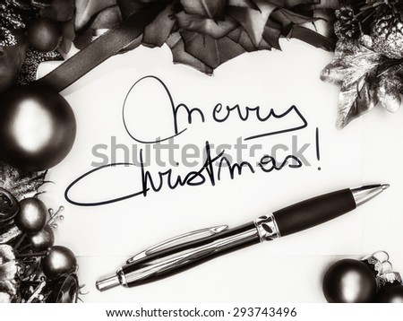 Merry christmas card with pen and decorations, monochrome image - stock photo