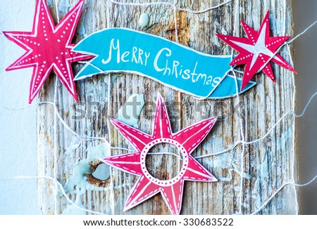 Merry Christmas decoration over grunge background/ vintage paper handmade christmas decoration on wooden background with copy space. Red star - stock photo