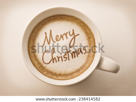 Merry christmas drawing on latte coffee cup  - stock photo