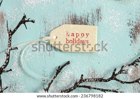 Merry Christmas festive baking concept with closeup on happy holidays gift tag on vintage style recycled wood background. - stock photo