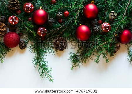 Merry Christmas Frame with real wood green pine, colorful baubles, gift boxe and other seasonal stuff over an old wooden aged background