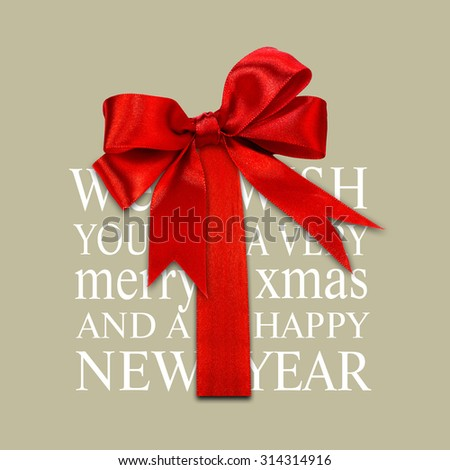 Merry Christmas gift box, holiday greetings typography with red ribbon - stock photo