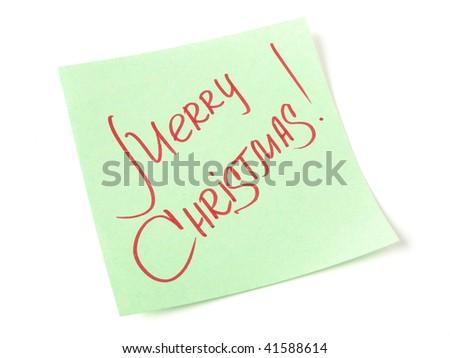 Merry Christmas handwritten message on green sticker - stock photo