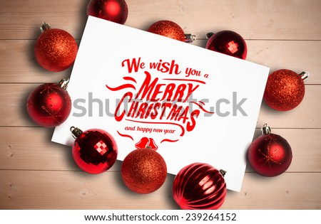 Merry christmas message against overhead of wooden planks - stock photo