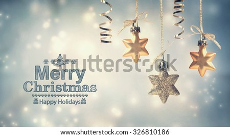 Merry Christmas message with hanging star ornaments - stock photo