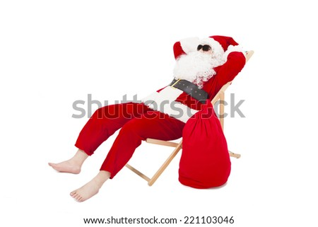 merry Christmas Santa Claus sitting on a chair with gift bag over white background - stock photo