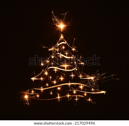 Merry Christmas tree greeting in bright sparkly stars on black background. - stock photo