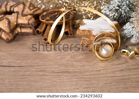 Merry Christmas! Wooden table with Christmas decorations and butter cookies. Space for your text - stock photo