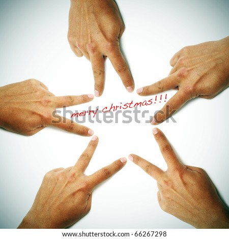 merry christmas written on a white background with hands drawing a star - stock photo