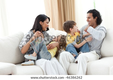 Merry family playing in the living room at home