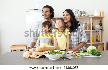 Merry family preparing lunch together in the kitchen