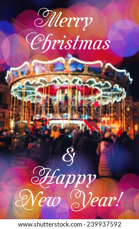 Merry-Go-Round illuminated at night. New year greeting on background with blurred carousel and bokeh. Merry Christmas and Happy New Year card. Wishing a happy holidays. - stock photo