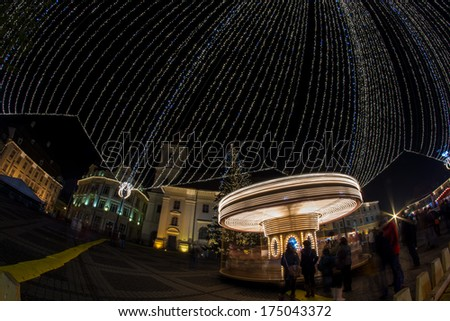 Merry-go-round with long shutter speed at the Christmas Fair in Hermannstadt, Transylvania  - stock photo