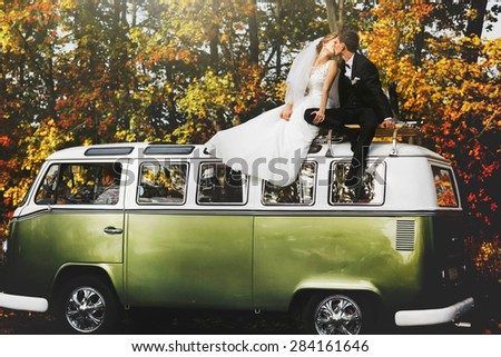 merry happy young couple on the background fabulous autumn forest - stock photo