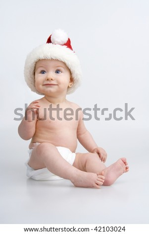 Merry little girl with Christmas cap,on white background. - stock photo