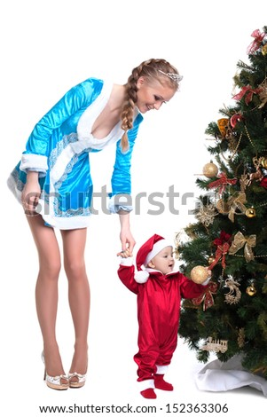 Merry mother-Snow Maiden keeps baby-Santa Claus - stock photo