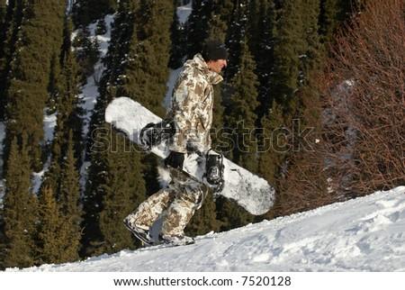 Merry snowboarder on ski slope - stock photo