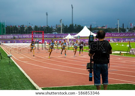MERSIN - TURKEY - JUNE 28: Unidentified racers head to the finish during the 110 meter hurdles dash at  Mediterranean Games Championships June 28, 2013 in Mersin Turkey  - stock photo