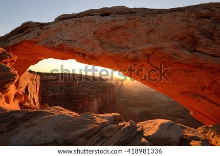 Mesa Arch Glowing in Canyonlands National Park at Sunrise - stock photo