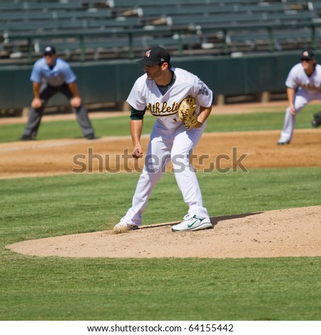 MESA, AZ - OCT. 19: Travis Banwart, a top prospect for the Oakland A's, pitches for the Phoenix Desert Dogs in an Arizona Fall League game Oct. 19, 2010 at Phoenix Municipal Stadium. The Dogs won 7-3. - stock photo