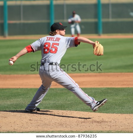 MESA, AZ - OCTOBER 26: Andrew Taylor, a Los Angeles Angels prospect, pitches for the Scottsdale Scorpions in an Arizona Fall League game Oct. 26, 2011 at HoHoKam Stadium. Taylor allowed one run. - stock photo