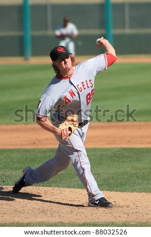 MESA, AZ - OCTOBER 26: Andrew Taylor, a Los Angeles Angels prospect, pitches for the Scottsdale Scorpions in the Arizona Fall League Oct. 26, 2011 at HoHoKam Stadium, Mesa, AZ. Taylor allowed one run. - stock photo