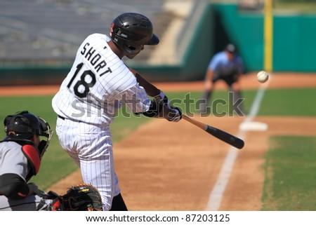 MESA, AZ - OCTOBER 17: Brandon Short, a Chicago White Sox prospect, bats for the Mesa Solar Sox in an Arizona Fall League game Oct. 17, 2011 at HoHoKam Stadium. Short went 1-for-3 with 2 runs scored. - stock photo