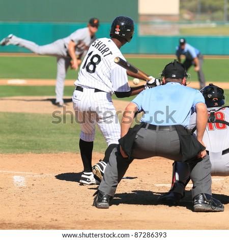 MESA, AZ - OCTOBER 17: Brandon Short, a Chicago White Sox prospect, bats for the Mesa Solar Sox in an Arizona Fall League game Oct. 17, 2011 at HoHoKam Stadium. Short went 1-for-3. - stock photo