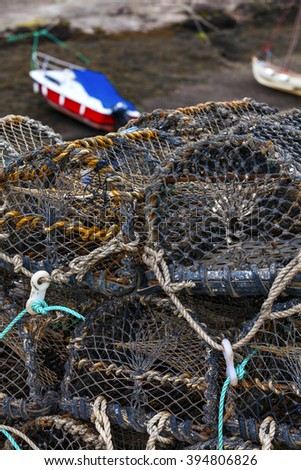 Mesh net shellfish traps at the sea harbor of St. Abbs, Scotland. Crab or lobster pots on quayside. - stock photo