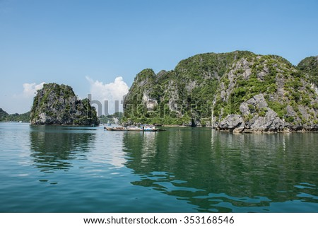 Mesmerizing image of the limestone karsts in Ha Long Bay, Vietnam. Thousands of limestone karsts make it a jaw-dropping beauty and UNESCO heritage site.Tourist boats are seen sailing. - stock photo