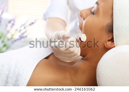 Mesotherapy, Mesotherapy microneedle, a cosmetic procedure. Beautician performs a needle mesotherapy treatment on a woman's face