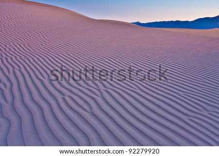 Mesquite Flat Sand dunes located in Death Valley National Park.  View of the texture of the dunes in the very early morning light. - stock photo