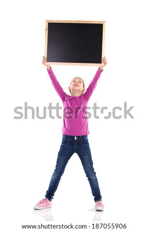 Message at the blackboard.Cute girl holding blackboard above head and reading. Full length studio shot isolated on white. - stock photo