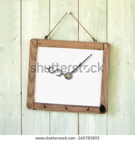 Message board of dollar sign clock hanging on retro green wooden wall background. Time is money concept. - stock photo