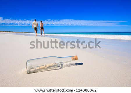 Message in a bottle on tropical beach