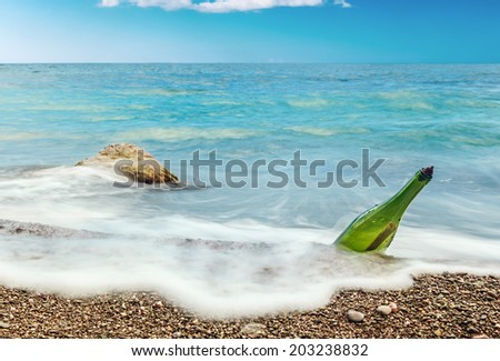 Message in bottle on sea-beach background - stock photo