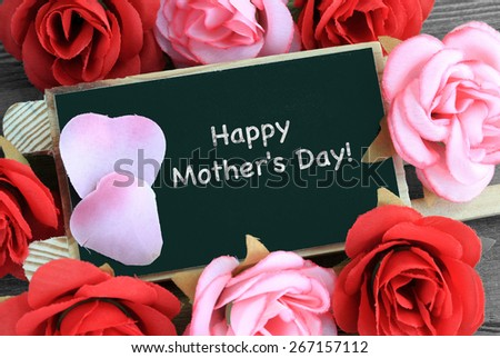 "message of ""happy mother's day"" with roses in the background - stock photo"
