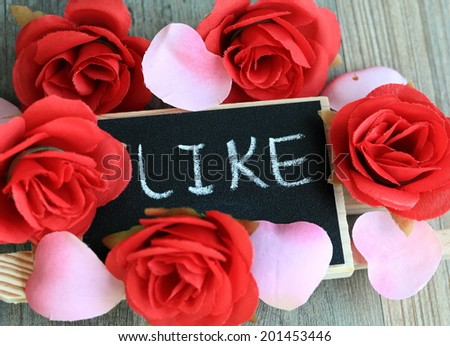 message of like with flowers in the background  - stock photo